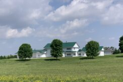 Acreage With 4,000 + Square Foot Home on Blacktop!
